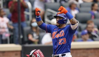New York Mets' Javier Baez gestures at home plate after his two-run home run that also scored Michael Conforto during the fourth inning of a baseball game against the Washington Nationals, Sunday, Aug. 29, 2021, in New York. (AP Photo/Corey Sipkin) **FILE**