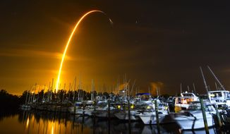 This long exposure photo shows the launch of a SpaceX Falcon 9 rocket on a resupply mission for NASA to the International Space Station from Pad 39A at Kennedy Space Center, seen from Merritt Island, Fla., Sunday, Aug. 29, 2021. The SpaceX shipment of ants, avocados and a human-sized robotic arm rocketed toward the International Space Station on Sunday. (Malcolm Denemark/Florida Today via AP)