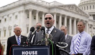 Rep. Clay Higgins, R-La., and other members of the conservative House Freedom Caucus call for the removal of President Joe Biden over the close of war in Afghanistan, at the Capitol in Washington, Tuesday, Aug. 31, 2021. (AP Photo/J. Scott Applewhite)
