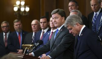 Rep. Mike Rogers, R-Ala., center, ranking member of the House Armed Services Committee, and Rep. Michael McCaul, R-Texas, right, ranking member of the House Foreign Affairs Committee and other GOP members criticize President Joe Biden and House Speaker Nancy Pelosi on the close of the war in Afghanistan, at the Capitol in Washington, Tuesday, Aug. 31, 2021. (AP Photo/J. Scott Applewhite)  **FILE**