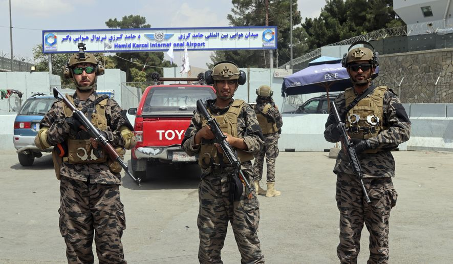 Taliban special forces fighters stand guard outside the Hamid Karzai International Airport after the U.S. military's withdrawal, in Kabul, Afghanistan, Tuesday, Aug. 31, 2021. The Taliban were in full control of Kabul's airport on Tuesday, after the last U.S. plane left its runway, marking the end of America's longest war. (AP Photo/Khwaja Tawfiq Sediqi)