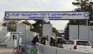 Taliban fighters stand guard in front of the Hamid Karzai International Airport after the U.S. withdrawal in Kabul, Afghanistan, Tuesday, Aug. 31, 2021. The Taliban were in full control of Kabul's international airport on Tuesday, after the last U.S. plane left its runway, marking the end of America's longest war. (AP Photo/Khwaja Tawfiq Sediqi)