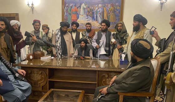 FILE - In this Aug. 15, 2021 file photo, Taliban fighters take control of Afghan presidential palace in Kabul, Afghanistan, after President Ashraf Ghani fled the country. (AP Photo/Zabi Karimi, File)