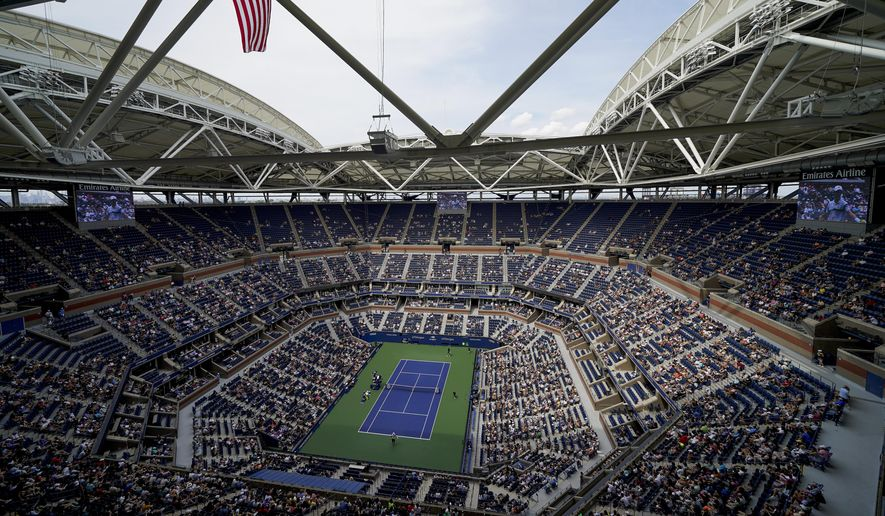 Tennis fans watch play between Alexander Zverev, of Germany, and Sam Querrey, of the United States, during the first round of the US Open tennis championships, Tuesday, Aug. 31, 2021, in New York. (AP Photo/John Minchillo)