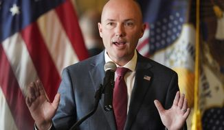 Gov. Spencer Cox speaks during a news conference Tuesday, Aug. 31, 2021, in Salt Lake City. Cox cast doubt on the efficacy of mask-wearing as health leaders made some of their most impassioned pleas yet for state residents to mask up and get vaccinated. Cox, a Republican, said his administration is encouraging people to wear masks but said it is unclear whether they are effective against the highly contagious delta variant of the coronavirus. (AP Photo/Rick Bowmer)