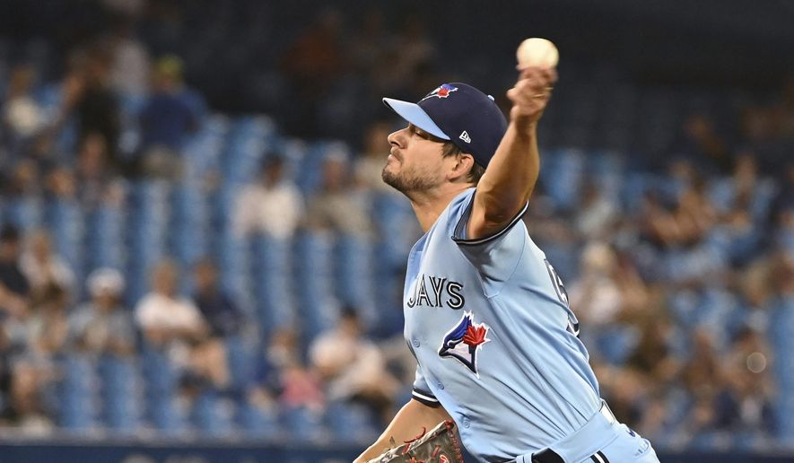 Toronto Blue Jays' Brad Hand pitches to a Chicago White Sox batter during the sixth inning of a baseball game Thursday, Aug. 26, 2021, in Toronto. (Jon Blacker/The Canadian Press via AP) **FILE**