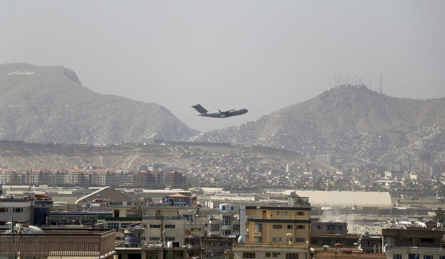 U.S military aircraft takes off at the Hamid Karzai International Airport in Kabul, Afghanistan, Saturday, Aug. 28, 2021.(AP Photo/Wali Sabawoon) ** FILE **