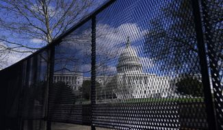 """In this April 2, 2021, file photo, the U.S. Capitol is seen behind security fencing on Capitol Hill in Washington. Extremist groups like the Proud Boys and Oath Keepers are planning to attend a rally in September at the U.S. Capitol that is designed to demand """"justice"""" for the hundreds of people who have been charged in connection with January's insurrection, according to three people familiar with intelligence gathered by federal officials. As a result, U.S. Capitol Police have been discussing in recent weeks whether the large perimeter fence that was erected outside of the Capitol after January's riot will need to be put back up, the people said.  (AP Photo/Carolyn Kaster, File)  **FILE**"""