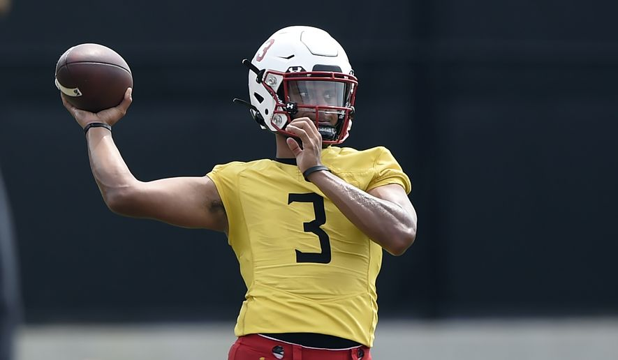 In this Aug. 6, 2021, file photo, Maryland football quarterback Taulia Tagovailoa throws during NCAA college football practice in College Park, Md. (AP Photo/Gail Burton, File)  **FILE**