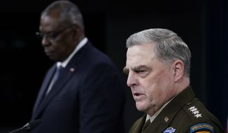 Joint Chiefs of Staff Gen. Mark Milley, right, answers a question during a briefing with Secretary of Defense Lloyd Austin, left, at the Pentagon in Washington, Wednesday, Sept. 1, 2021, about the end of the war in Afghanistan. (AP Photo/Susan Walsh)  **FILE**