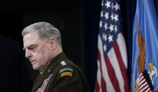 Joint Chiefs of Staff Gen. Mark Milley listens during a briefing with Secretary of Defense Lloyd Austin at the Pentagon in Washington, Wednesday, Sept. 1, 2021, about the end of the war in Afghanistan. (AP Photo/Susan Walsh)