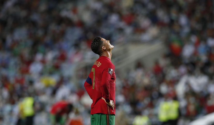 Portugal's Cristiano Ronaldo reacts during the World Cup 2022 group A qualifying soccer match between Portugal and the Republic of Ireland at the Algarve stadium outside Faro, Portugal, Wednesday, Sept. 1, 2021. (AP Photo/Armando Franca) **FILE**