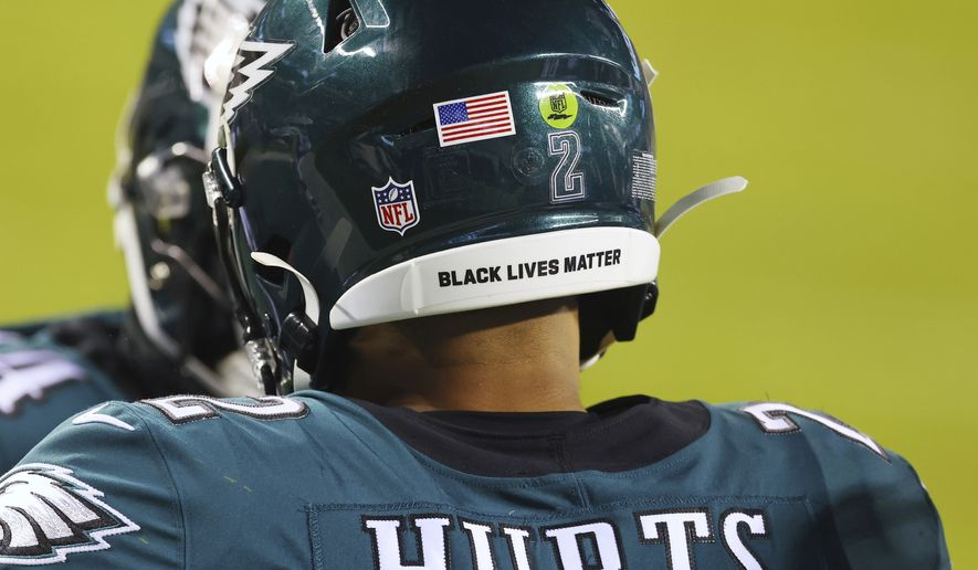 In this Jan. 3, 2021, file photo, Philadelphia Eagles Jalen Hurts wears a Black Lives Matter decal on the back of his helmet during the team's NFL football game against the Washington Football Team in Philadelphia. NFL players can wear social justice messages on their helmets again this season and It Takes All of Us and End Racism will be stenciled in end zones for the second straight year as part of the leagues Inspire Change platform. (AP Photo/Rich Schultz, File) **FILE**