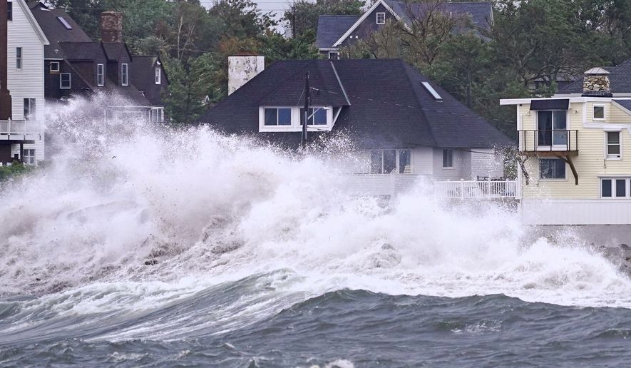 Waves slam along the shore near high tide as the remnants of Hurricane Ida leave coastal Massachusetts, Thursday, Sept. 2, 2021, in Scituate, Mass. (AP Photo/Charles Krupa)