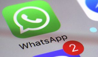 This March 10, 2017 file photo shows the WhatsApp communications app on a smartphone, in New York. (AP Photo/Patrick Sison, File)  **FILE**