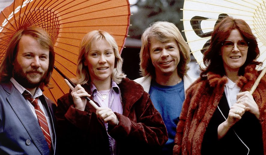 """Members of the pop group ABBA, from left, Benny Andersson, Agnetha Foltskog, Bjorn Ulvaeus and Anni-Frid Lyngstad, appear in Tokyo on March 14, 1980. ABBA is releasing its first new music in four decades, along with a concert performance that will see the """"Dancing Queen"""" quartet going entirely digital.  The forthcoming album """"Voyage,"""" to be released Nov. 5, is a follow-up to 1981's """"The Visitors,"""" which until now had been the swan song of the Swedish supergroup. (AP Photo/Tsugufumi Matsumoto, File)"""