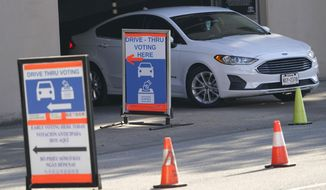 A car leaves a drive-thru voting site on Election Day on Nov. 3, 2020, in Houston. Texas has become the latest state where Republicans have rolled back access to voting methods that soared in popularity during last year's pandemic presidential election. Following similar legislation in Arizona, Florida, Georgia, Iowa and some other GOP-controlled states, Texas Republicans passed new restrictions on mail-in balloting as well as bans on 24-hour polling places and drive-thru voting. (AP Photo/David J. Phillip) **FILE**