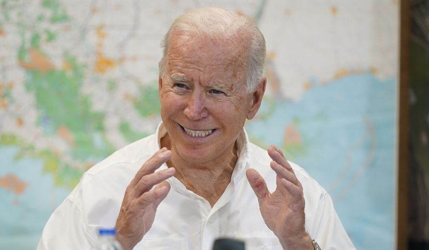 President Joe Biden participates in a briefing about the response to damage caused by Hurricane Ida, at the St. John Parish Emergency Operations Center, Friday, Sept. 3, 2021, in LaPlace, La. (AP Photo/Evan Vucci)