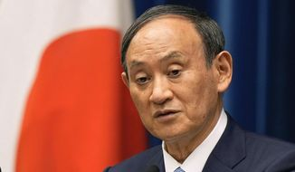 In this Aug. 17, 2021, file photo, Japanese Prime Minister Yoshihide Suga speaks during a news conference at the prime minister's official residence in Tokyo. Broadcaster NHK says Friday, Sept. 3, 2021, Suga won't run for party leader, hinting he will resign as Japanese leader at the end of September. (Kimimasa Mayama/Pool Photo via AP, File)