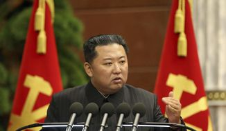 """In this photo provided by the North Korean government, North Korean leader Kim Jong-un delivers a speech during a Politburo meeting in Pyongyang, North Korea Thursday, Sept. 2, 2021. Independent journalists were not given access to cover the event depicted in this image distributed by the North Korean government. The content of this image is as provided and cannot be independently verified. Korean language watermark on image as provided by source reads: """"KCNA"""" which is the abbreviation for Korean Central News Agency. (Korean Central News Agency/Korea News Service via AP) **FILE**"""