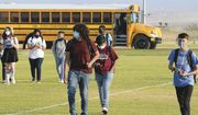 In this Sept. 17, 2020, photo, students in face masks arrive on the Gila Ridge High School campus on the second first day of school, in Yuma, Ariz. (Randy Hoeft/The Yuma Sun via AP) **FILE**