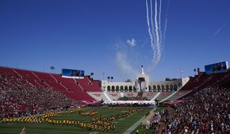 Airplanes fly over Los Angeles Memorial Coliseum before an NCAA college football game between San Jose State and Southern California Saturday, Sept. 4, 2021, in Los Angeles. (AP Photo/Ashley Landis) **FILE**