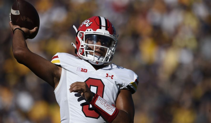 Maryland quarterback Taulia Tagovailoa looks to pass against West Virginia in the first half of an NCAA college football game, Saturday, Sept. 4, 2021 in College Park, Md. (AP Photo/Gail Burton)