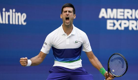Novak Djokovic, of Serbia, reacts after scoring a point against Kei Nishikori, of Japan, during the third round of the US Open tennis championships, Saturday, Sept. 4, 2021, in New York. (AP Photo/John Minchillo) **FILE**