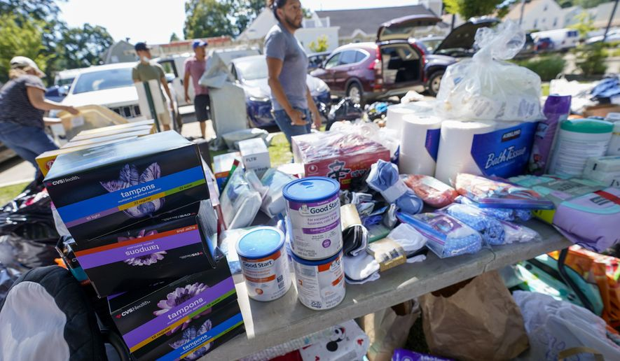 Volunteers with a Seventh Day Adventist church sort donated items to be distributed to people in need after remnants of Hurricane Ida inundated the community, Saturday, Sept. 4, 2021, in Mamaroneck, N.Y. More than four days after the hurricane blew ashore in Louisiana, Ida's rainy remains hit the Northeast with stunning fury on Wednesday and Thursday, submerging cars, swamping subway stations and basement apartments and drowning scores of people in five states. (AP Photo/Mary Altaffer) **FILE**