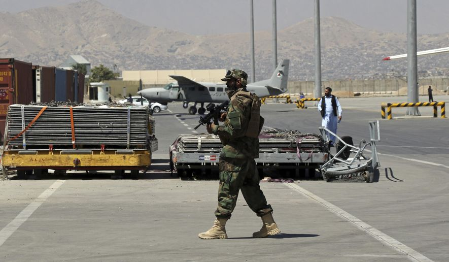 A Taliban soldier walks on the tarmac at Hamid Karzai International Airport in Kabul, Afghanistan, Sunday, Sept. 5, 2021. Some domestic flights have resumed at Kabul's airport, with the state-run Ariana Afghan Airline operating flights to three provinces. (AP Photo/Wali Sabawoon) ** FILE **