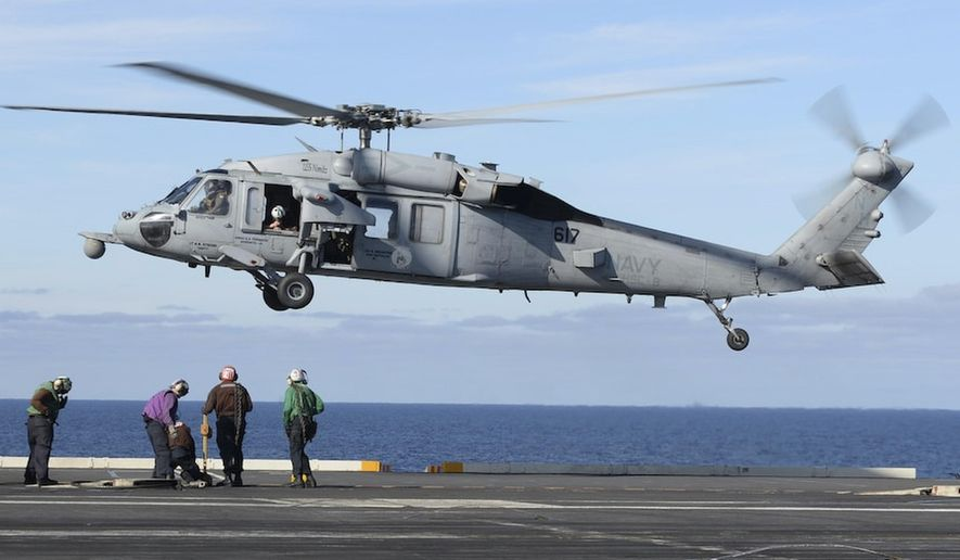 In this March 19, 2017, file photo released by the U.S. Navy, an MH-60S Sea Hawk helicopter prepares to land on the flight deck of the aircraft carrier USS Nimitz in the Pacific Ocean. The Navy declared five missing sailors dead Saturday, Sept. 4, 2021, nearly a week after their helicopter, similar to the one pictured, crashed in the ocean off San Diego. (Mass Communication Specialist Seaman Ian Kinkead/U.S. Navy via AP) ** FILE **