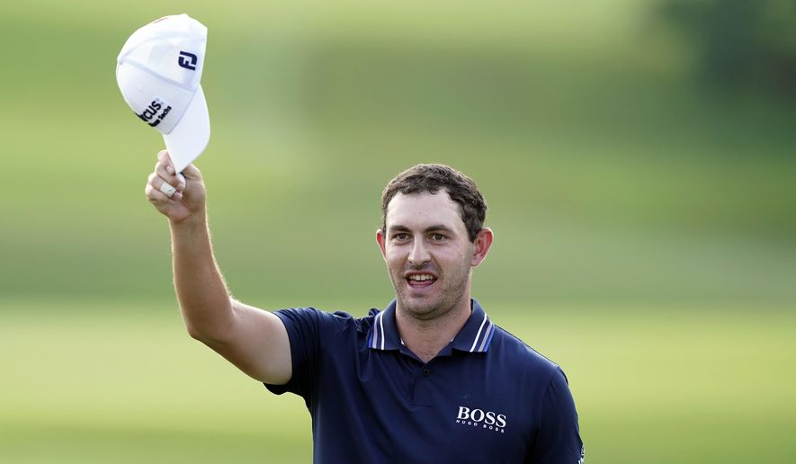 Patrick Cantlay tips his cap to the crowd after winning the Tour Championship golf tournament and the FedEx Cup at East Lake Golf Club, Sunday, Sept. 5, 2021, in Atlanta. (AP Photo/Brynn Anderson)