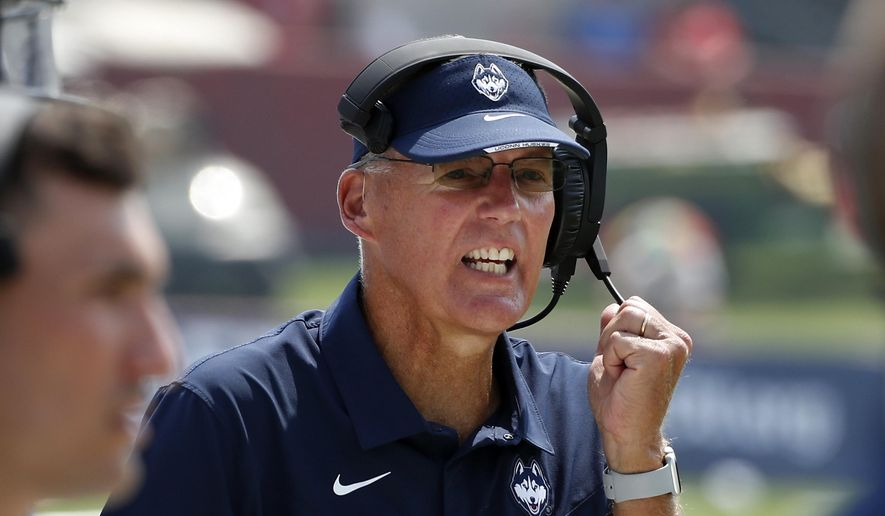 In this Aug. 28, 2021, file photo, Connecticut coach Randy Edsall coaches his team against Fresno State during the second half of an NCAA college football game in Fresno, Calif. Edsall, whose teams have won just six games since he returned to the Huskies for a second stint as coach in 2017 has announced that he will retire at the end of the season. (AP Photo/Gary Kazanjian, File) **FILE**