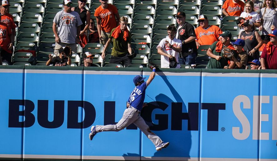 Kansas City Royals left fielder Andrew Benintendi makes a catch on a ball hit by Baltimore Orioles' Anthony Santander during the ninth inning of a baseball game, Monday, Sept. 6, 2021, in Baltimore. The Royals won 3-2. (AP Photo/Julio Cortez)