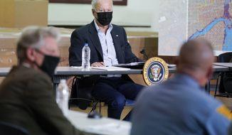 President Joe Biden listens during a briefing about the impact of Hurricane Ida, Tuesday, Sept. 7, 2021, in Hillsborough Township, N.J. (AP Photo/Evan Vucci)
