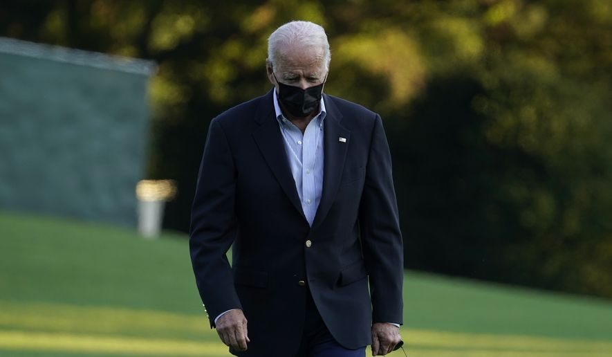 President Joe Biden walks across the South Lawn of the White House in Washington, Tuesday, Sept. 7, 2021, after returning from a trip to New York and New Jersey to survey damage from the remnants of Hurricane Ida. (AP Photo/Susan Walsh)