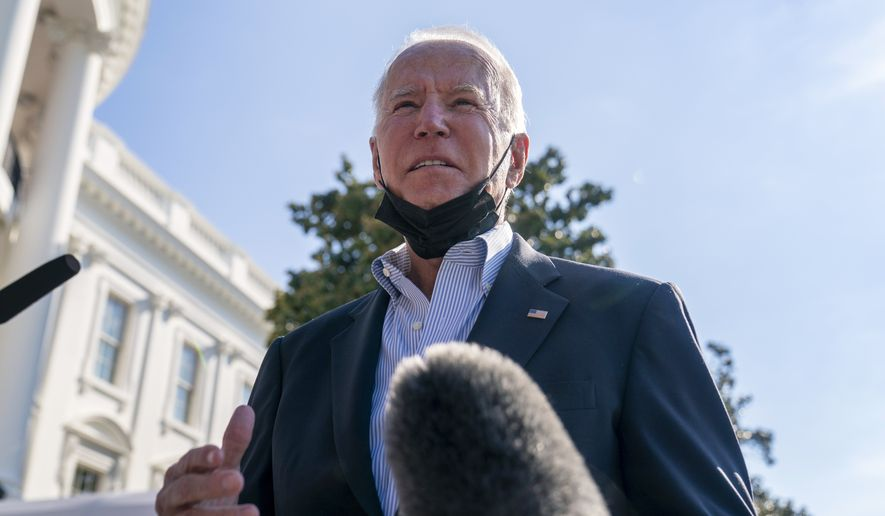 President Joe Biden speaks with reporters before boarding Marine One on the South Lawn of the White House in Washington, Tuesday, Sept. 7, 2021, for a short trip to Andrews Air Force Base, Md., and then to New York and New Jersey to survey damage from Hurricane Ida. (AP Photo/Andrew Harnik)