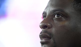 In this Aug. 31, 2017, photo, Washington Redskins radio analyst and former running back Clinton Portis watches from the sideline during the second half of an NFL preseason football game against the Tampa Bay Buccaneers in Tampa, Fla. Former NFL players Clinton Portis, Tamarick Vanover and Robert McCune pleaded guilty for their roles in a nationwide healthcare fraud scheme, the U.S. Department of Justice announced Tuesday, Sept. 7, 2021.. (AP Photo/Phelan M. Ebenhack) **FILE**