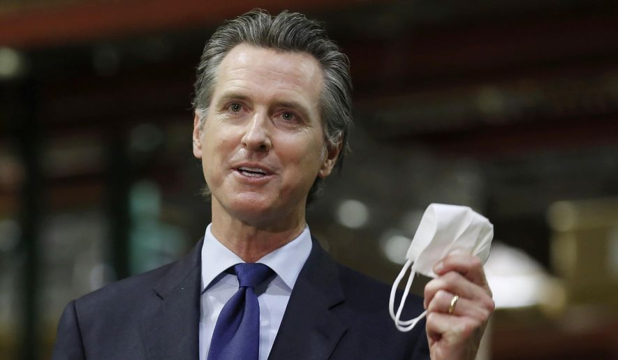FILE — In this June 26, 2020, file photo, California Gov. Gavin Newsom displays a face mask as he calls on people wear them to fight the coronavirus, during a news conference in Rancho Cordova, Calif. Newsom is facing the second recall of a governor in California history, and the last day to vote is Sept. 14, 2021. The coronavirus has been a dominating factor in the recall, which was first launched last year. (AP Photo/Rich Pedroncelli, Pool, File)