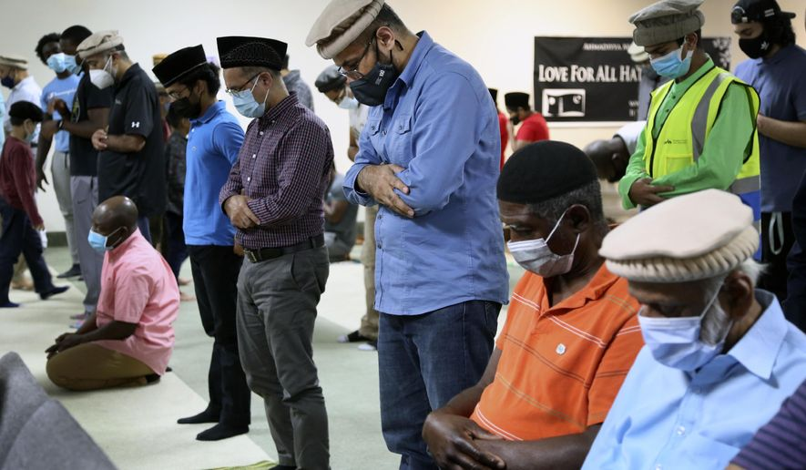 Mansoor Shams (center) and other community members attend Friday prayer on Aug. 13, 2021, in Rosedale, Md. (AP Photo/Jessie Wardarski) **FILE**