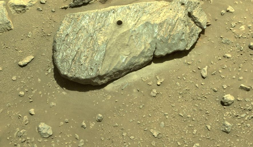 This Sept. 1, 2021 image provided by NASA shows the hole drilled by the Perseverance rover during its second sample-collection attempt in Mars' Jezero Crater. (NASA/JPL-Caltech via AP)