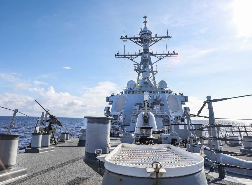 The Arleigh Burke-class guided-missile destroyer USS Benfold (DDG 65) sails through the South China Sea while conducting routine underway operations. Benfold is forward-deployed to the U.S. 7th Fleet area of operations in support of a free and open Indo-Pacific. (U.S. Navy photo by Mass Communication Specialist 1st Class Deanna C. Gonzales)
