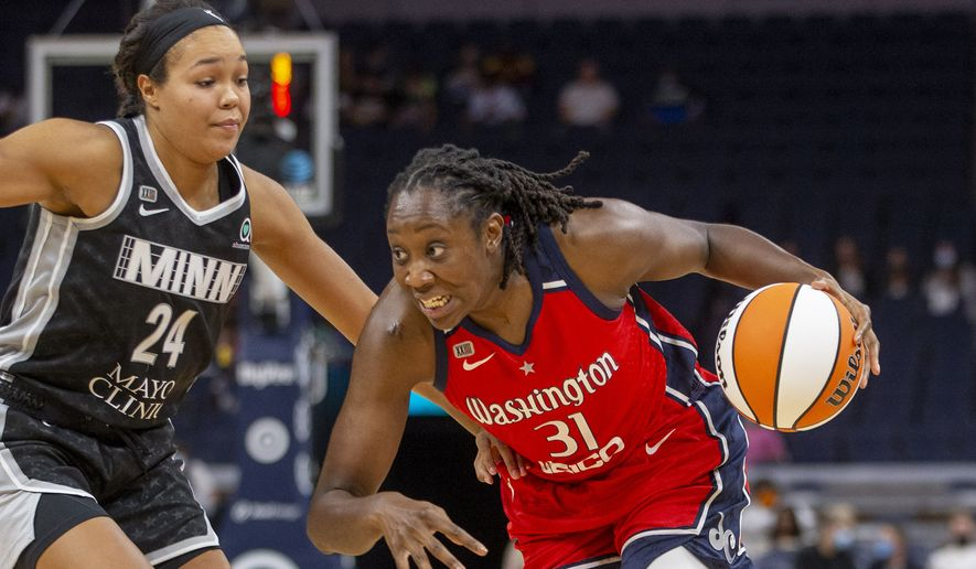 Washington Mystics center Tina Charles (31) drives to the basket around Minnesota Lynx forward Napheesa Collier (24) in the third quarter of a WNBA basketball game Saturday, Sept. 4, 2021, in Minneapolis. The Lynx won 93-75. (AP Photo/Bruce Kluckhohn) **FILE**