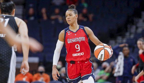 Washington Mystics guard Natasha Cloud (9) brings the ball up court against the Minnesota Lynx in the third quarter of a WNBA basketball game Saturday, Sept. 4, 2021, in Minneapolis. The Lynx won 93-75. (AP Photo/Bruce Kluckhohn) **FILE**