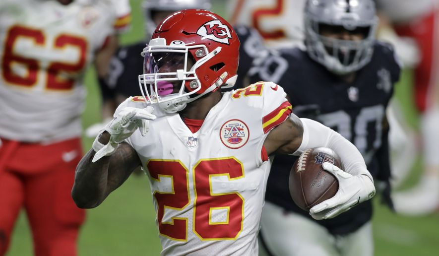 In this Nov. 22, 2020, file photo, Kansas City Chiefs running back Le'Veon Bell (26) carries the ball against the Las Vegas Raiders during the first half of an NFL football game in Las Vegas. The Baltimore Ravens signed Bell to their practice squad, adding another backfield option in the aftermath of J.K. Dobbins season-ending injury. Bell was cut early last season by the New York Jets, then rushed for 328 yards in 11 games with Kansas City. He did not play in the Super Bowl for the Chiefs. (AP Photo/Isaac Brekken, File) **FILE**