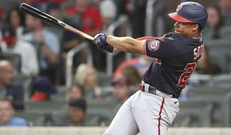Washington Nationals' Juan Soto hits a solo home run against the Atlanta Braves during the seventh inning of a baseball game Wednesday, Sept 8, 2021, in Atlanta. (Curtis Compton/Atlanta Journal-Constitution via AP)