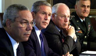 """FILE - In this Wednesday, Sept. 12, 2001 file photo, from left, Secretary of State Colin Powell, President George W. Bush, Vice President Dick Cheney and Chairman of the Joint Chiefs of Staff Gen. Henry Shelton attend a meeting with the National Security Council in the Cabinet Room of the White House. While the Secret Service played """"hide the president"""" with Bush on Sept. 11 — he was shuttled to military bases in Louisiana and Nebraska, for fear of terrorist attacks — his vice president hunkered down in a """"secure, undisclosed location,"""" a bunker inside the White House where he helped direct the government's actions. (AP Photo/Doug Mills, File)"""