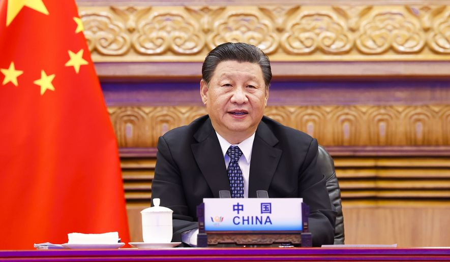 In this photo released by Xinhua News Agency, Chinese President Xi Jinping attends the 13th BRICS summit via video link in Beijing, China Thursday, Sept. 9, 2021. (Huang Jingwen/Xinhua via AP)