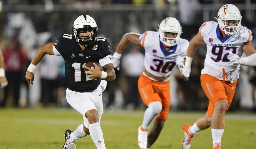 Central Florida quarterback Dillon Gabriel, left, runs for yardage past Boise State defensive end Isaiah Bagnah (30) and defensive tackle Michael Callahan (92) during the first half of an NCAA college football game Thursday, Sept. 2, 2021, in Orlando, Fla. (AP Photo/John Raoux) **FILE**