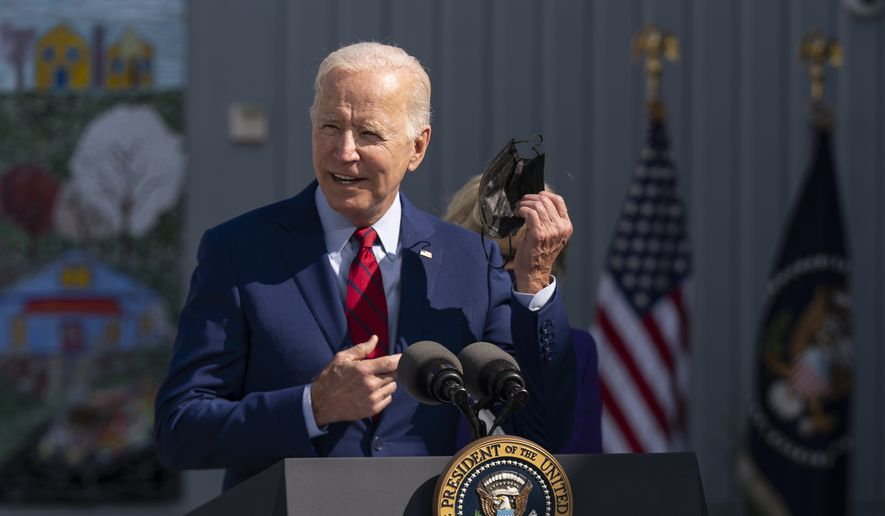 President Joe Biden, takes off his mask as he speaks to school staff during a visit at Brookland Middle School in northeast Washington, Friday, Sept. 10, 2021.  (AP Photo/Manuel Balce Ceneta)
